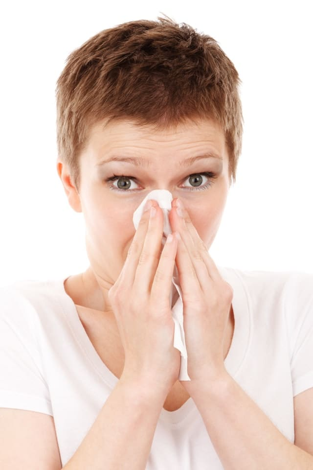 Woman blowing her nose with tissue - Las Vegas